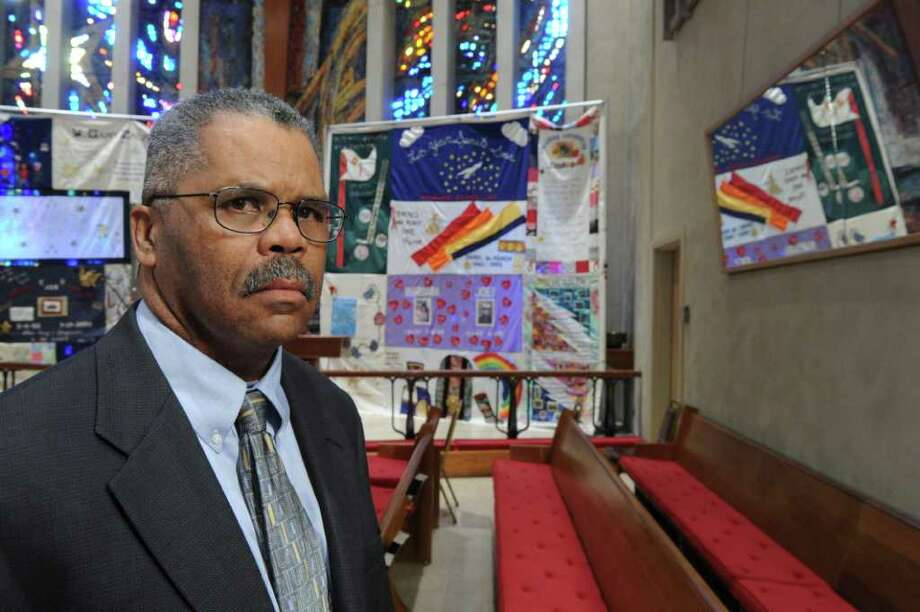 Rev. Douglas McArthur, Chairman of AIDS Interfaith Stamford, on the altar of the First United Methodist Church, where he is also Senior Pastor, November 30, 2011. The church will host the 14th Annual World AIDS Day Interfaith Service December 1 at 7 PM. Each year the altar is draped in the same six quilt panels provided by the Names Project Foundation, the panels memorialize Stamford residents who were felled by the virus. Thursday's service, which is open to the public, will focus on remembrance, awareness, hope and healing. Photo: Keelin Daly