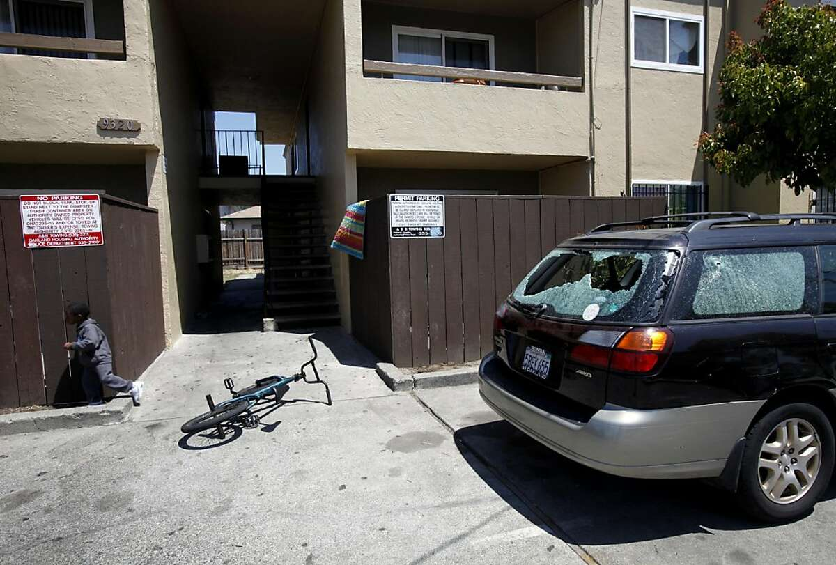 A Subaru has shattered windows from the gunfire that killed Najon Jackson, 16, outside this apartment complex in Oakland, Calif., Monday, August 1, 2011. Jackson was shot and killed outside the apartment Saturday night.