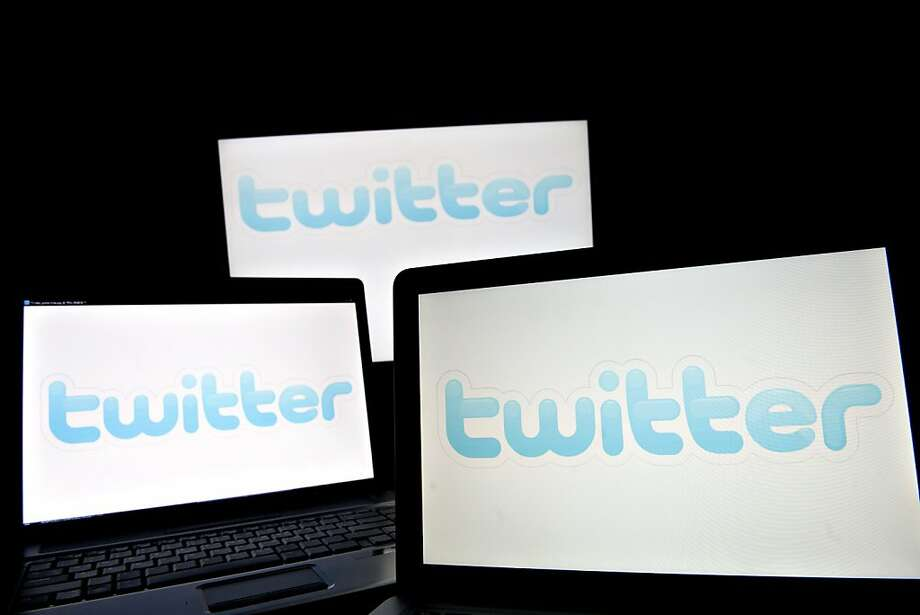 Twitter Inc. logos are displayed on computer screens in Tiskilwa, Illinois, U.S., on Tuesday, Jan. 25, 2011. Twitter will probably more than triple its advertising revenue to $150 million this year as more companies use it to spread marketing messages, according to Internet researcher EMarketer Inc. Photographer: Daniel Acker/Bloomberg Photo: Daniel Acker, Bloomberg