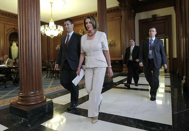 House Democratic leader Nancy Pelosi of California, a critic of the debt deal agreement, walks to the floor of the House to vote on the emergency legislation to avert a government default, at the Capitol, in Washington, Monday, Aug. 1, 2011. Photo: J. Scott Applewhite, AP