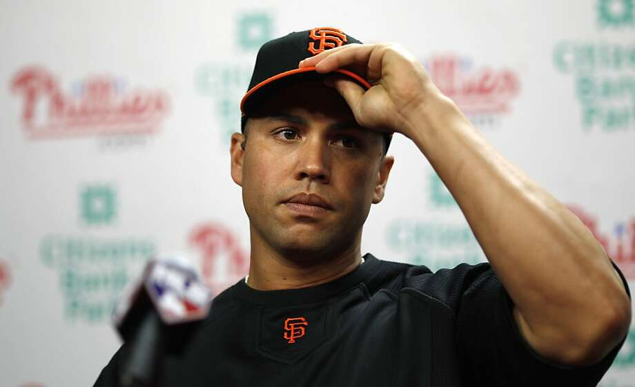 San Francisco Giants' Carlos Beltran adjusts his hat during a news conference before a baseball game against the Philadelphia Phillies, Thursday, July 28, 2011, in Philadelphia. The defending World Series champions acquired the All-Star outfielder in a trade with the New York Mets. Photo: Matt Slocum, AP