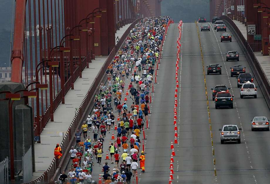 San Francisco Marathon runners cross the Golden Gate Bridge on Sunday. Photo: Brant Ward, The Chronicle