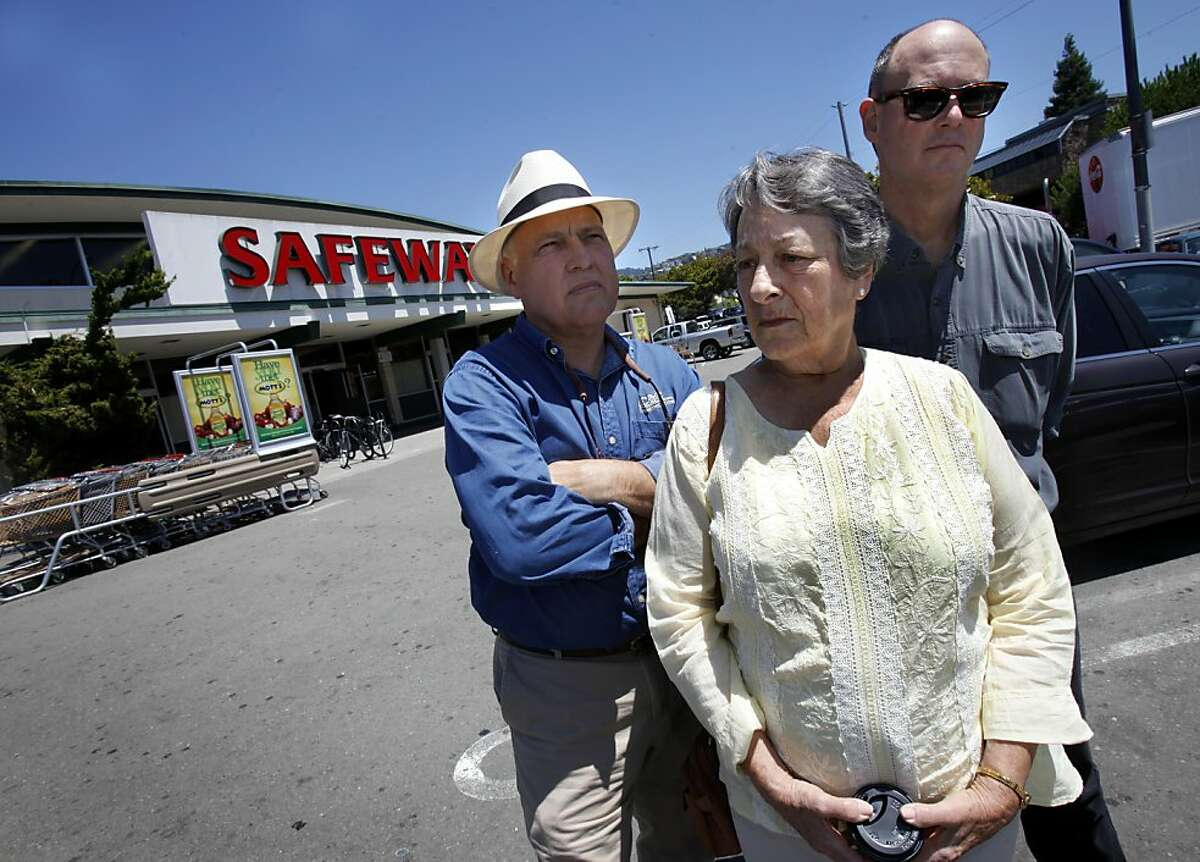Cliff Cline (left), Susan Shawl and Peter St. John (right) are not against Safeway, but against their expansion which would eliminate the parking lot they stand in Tuesday July 19, 2011. Neighbors in the Rockridge and Elmwood areas are fighting a proposed Safeway store expansion which will double the size of the existing store on College Avenue near the Oakland/Berkeley, Calif. border.