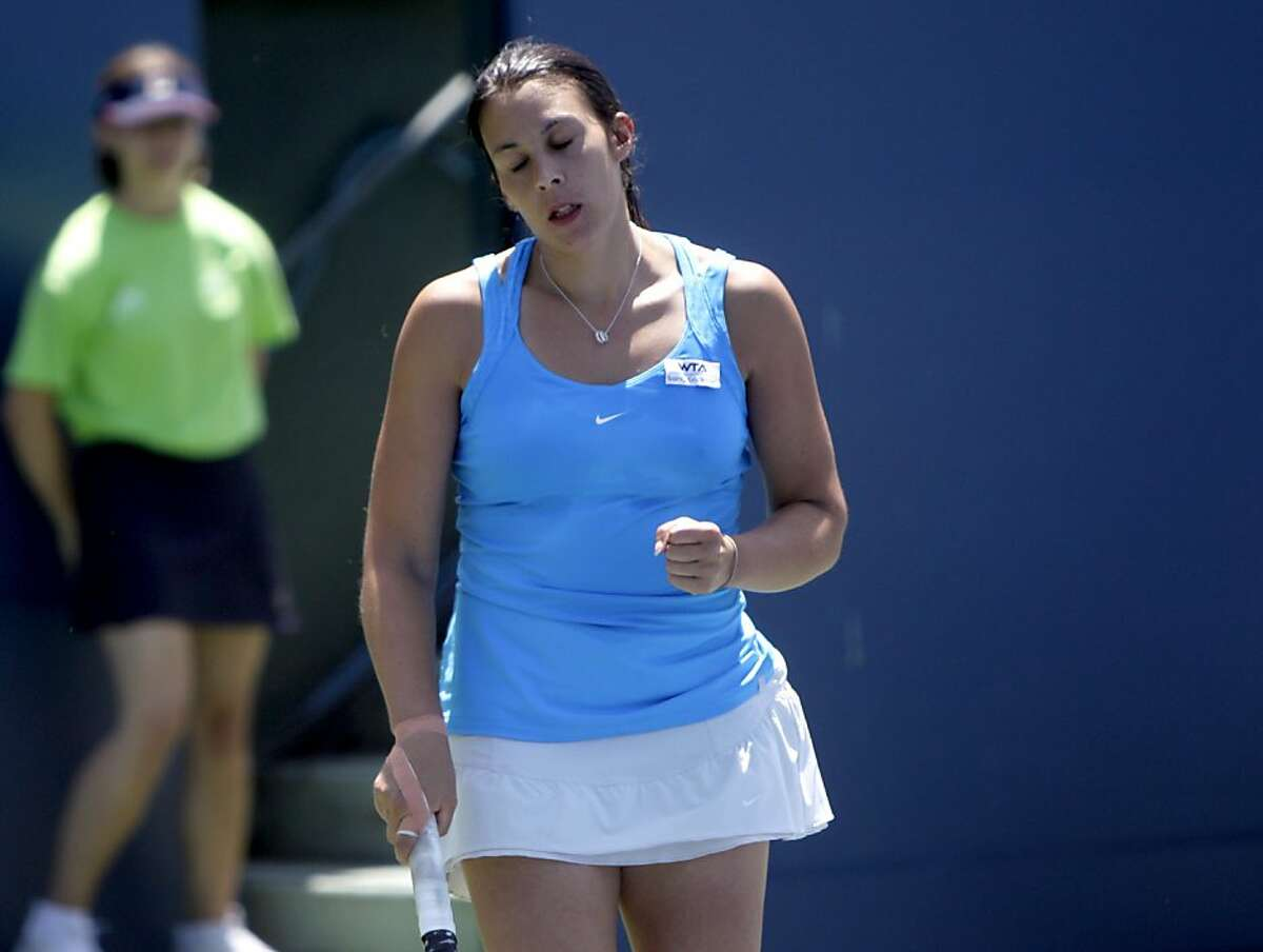 Marion Bartoli reacts to losing a point in the second set against Serena Williams in the finals of the Bank of the West Classic, Sunday July 31, 2011, in Stanford, Calif. Williams defeated Bartoli 7-5, 6-1.