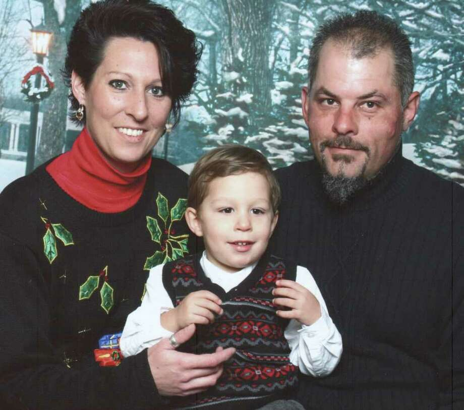 Dawn Wright, left, with her boyfriend Scott Loiselle, right, and their son Xavier, in November 2010. (Family photo)