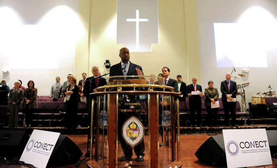 Rev. Anthony Bennett, of Mount Aery Baptist Church in Bridgeport and Co-Chair of CONECT (Congregations Organized for a New Connecticut) held their founding assembly at the Cathedral of the Holy Spirit Church in Bridgeport, Conn. on Wednesday November 30, 2011. Photo: Christian Abraham / Connecticut Post