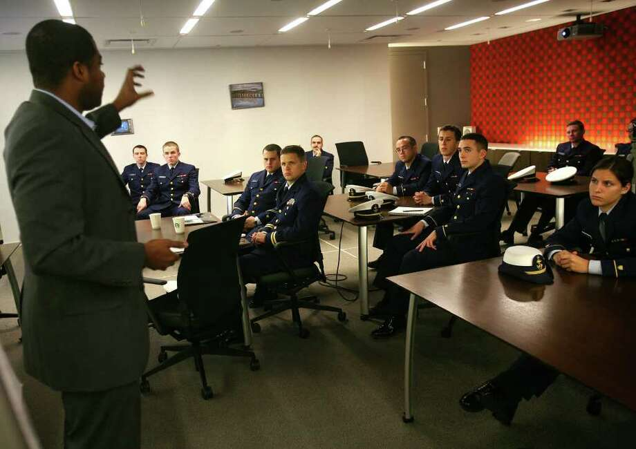 Coast Guard Academy cadets listen to a presentation by Alonzo Ford, senior equity analyst, during a career day visit to G.E. Capital Real Estate in Norwalk on Wednesday, November 20, 2011. Photo: Brian A. Pounds / Connecticut Post