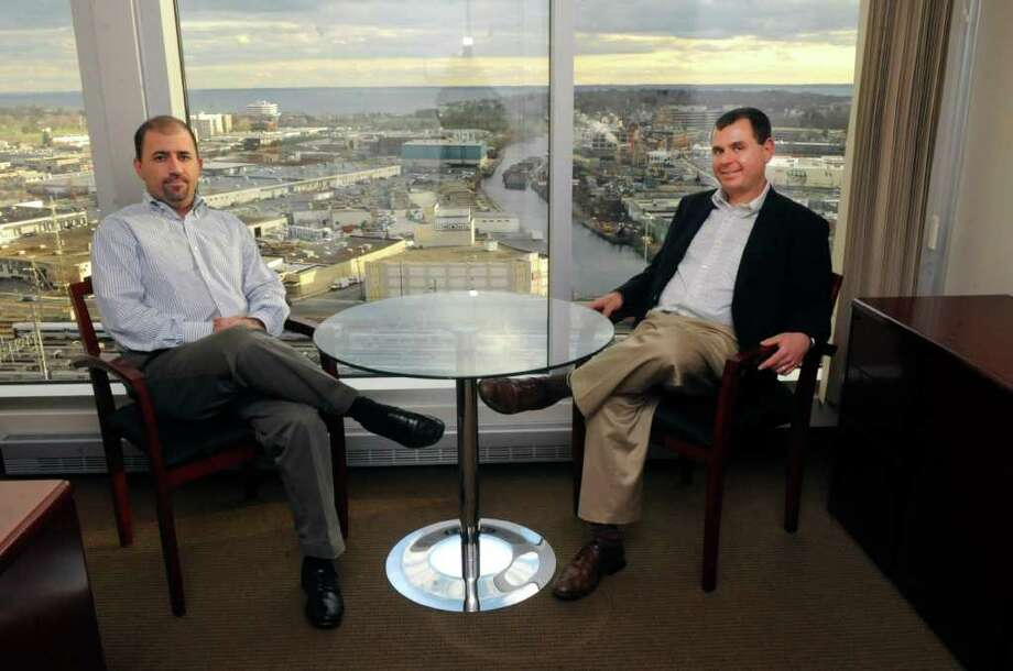 Ben Blumberg, vice president of Start Office Suites left, and Adams Stark, president, sit in one of the offices atop the Stamford Marriott  Wednesday, Nov. 30, 2011, where their company has converted the revolving top floor restaurant into offices. Photo: Helen Neafsey / Greenwich Time
