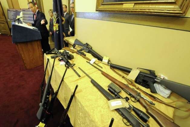 Guns on display as Attorney General Eric. T. Schneiderman gave some details about an ongoing investigation into the illegal sales of firearms at gun shows across the state during a press conference in the Capital in Albany, N.Y. Nov. 30, 2011.   (Skip Dickstein/Times Union) Photo: Skip Dickstein / 2011