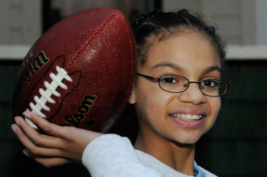 Eleven-year-old Kelsey Brown of Scotia will compete in the NFL's Punt,Pass and Kick competition on December 11 at the New York Jets game.Scotia, NY Tuesday, Nov.29, 2011.( Michael P. Farrell/Times Union) Photo: Michael P. Farrell