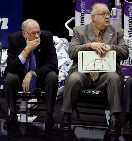 "FILE - In this March 25, 2010, file photo, Syracuse coach Jim Boeheim, left, and associate head basketball coach Bernie Fine sit on the bench at the end an NCAA West Regional semifinal college basketball game against Butler in Salt Lake City. Fine was fired Sunday, Nov. 27, 2011, in the wake of an investigation of child molestation allegations against him. In statement released Sunday night, Kevin Quinn, the school's senior vice president for public affairs, says Fine has been ""terminated, effective immediately."" (AP Photo/Steve C. Wilson, File) Photo: Steve C. Wilson"