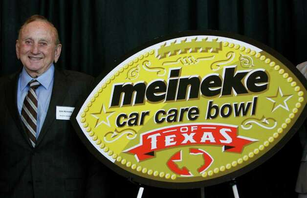 Sam Meineke, founder of Meineke Car Care Centers, stands next to the new logo for the Meineke Car Care Bowl of Texas during the press conference to announce that ESPN Regional Television (ERT), Inc., a subsidiary of ESPN, and Meineke Car Care Centers signed a three year title sponsorship deal for the Texas Bowl, at Reliant Stadium, Tuesday, April 12, 2011, in Houston.   The annual game will match up the Big 12 versus the Big Ten, and 2011 will be the first year of the deal. Photo: Karen Warren, Houston Chronicle / Houston Chronicle