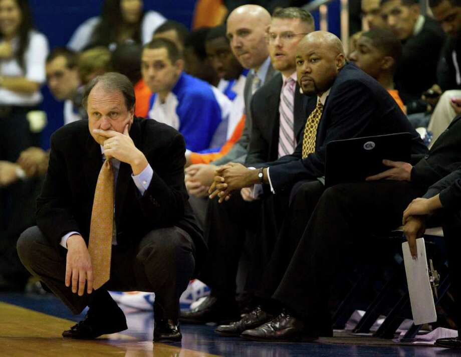 Houston Baptist head coach Ron Cottrell, left, watches his team during the second half of an NCAA college basketball game against Rice at Sharp Gym Wednesday, Nov. 30, 2011, in Houston. Rice beat HBU 78-66. Photo: Brett Coomer, Houston Chronicle / © 2011 Houston Chronicle