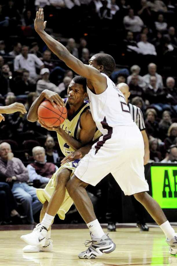 Nov. 30: Texas A&M 56, ALcorn State 44Alcorn State guard Twann Oakley, left, tries to drive the ball around Texas A&M guard Naji Hibbert (2) during the second half. Photo: Pat Sullivan, Associated Press / AP
