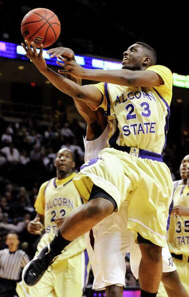 Alcorn State guard Xavian Rimmer (23) is fouled by Texas A&M guard Naji Hibbert during the secon