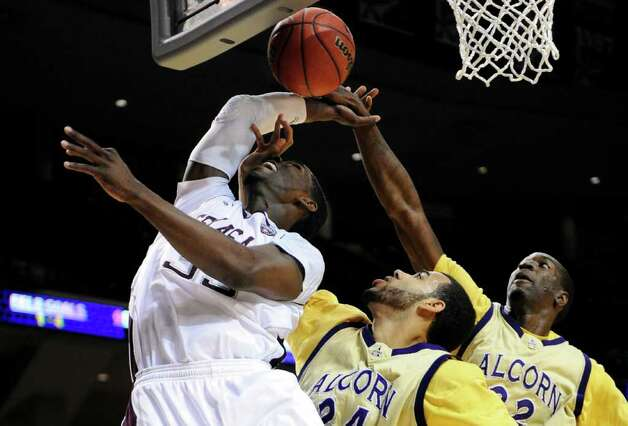 Texas A&M forward Ray Turner (35) is pressured by Alcorn State's Ian Francis (24) and Chris Brand (22) during the first half of an NCAA college basketball game, Wednesday, Nov. 30, 2011, in College Station, Texas. (AP Photo/Pat Sullivan) Photo: Pat Sullivan / Associated Press