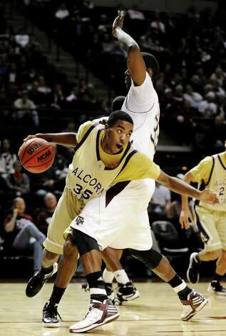 Alcorn State forward KeDorian Sullivan (35) tries to get around Texas A&M forward Ray Turner, right, during the second half of an NCAA college basketball game, Wednesday, Nov. 30, 2011, in College Station, Texas. Texas A&M won 56-44. (AP Photo/Pat Sullivan) Photo: Pat Sullivan / Associated Press