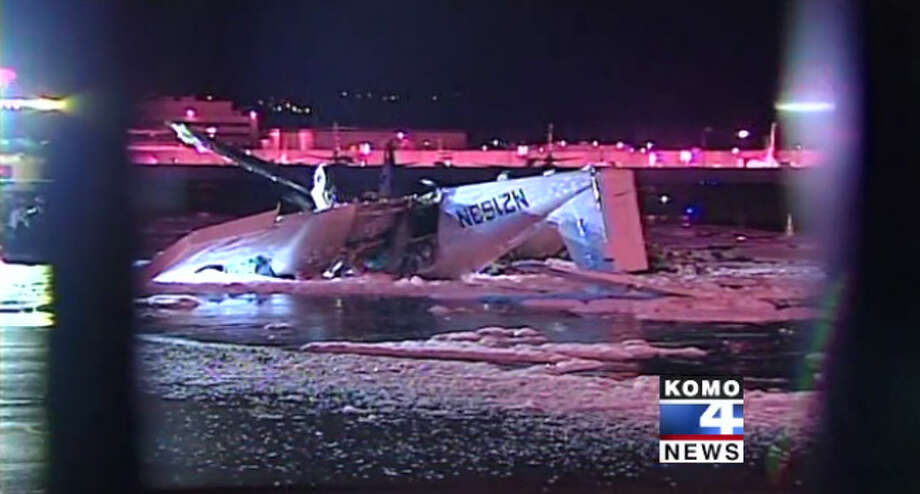 A small prop airplane with two people aboard crashed into an empty parked plane shortly after taking off at Seattle's Boeing Field late Wednesday, Nov. 30. Photo: KOMO-TV