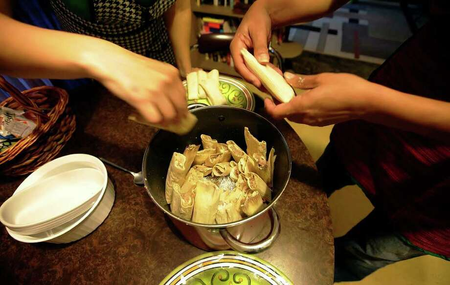 It's time to either place orders for your favorite local tamales or participate in a tamalada, a tamal-making party. Photo: KIN MAN HUI, Kin Man Hui/kmhui@express-news.net / kmhui@express-news.net