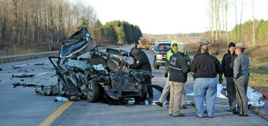 New York State Police investigators begin the task of determining the cause of a multi-car fatal accident on I-88 in Duanesburg, N.Y. December 1, 2011.      (Skip Dickstein / Times Union) Photo: SKIP DICKSTEIN / 2011
