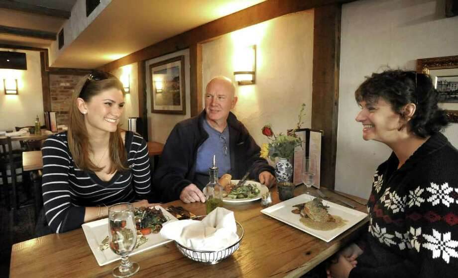 Meghan Ledan, left, lunches with her parents, Ray and Norma Ledan in the lounge at Stella Restaurant and Bar in Bethel on Nov. 21, 2011. Stella is participating in Bethel Restaurant Week. Photo: Michael Duffy