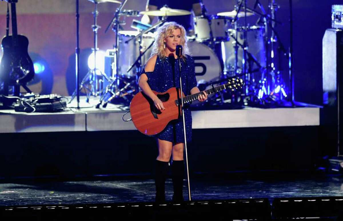 LOS ANGELES, CA - NOVEMBER 30: Musician Kimberly Perry of The Band Perry performs onstage durnig The GRAMMY Nominations Concert Live! Countdown to Music's Biggest Night at Nokia Theatre L.A. Live on November 30, 2011 in Los Angeles, California.