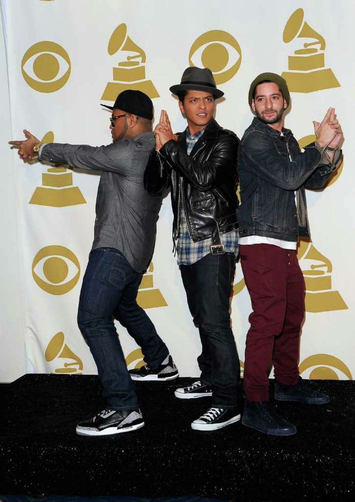 LOS ANGELES, CA - NOVEMBER 30: (L-R) Producer Philip Lawrence; musician Bruno Mars, and producer Ari Levine pose in media room at The GRAMMY Nominations Concert Live! Countdown to Music's Biggest Night at Nokia Theatre L.A. Live on November 30, 2011 in Los Angeles, California.