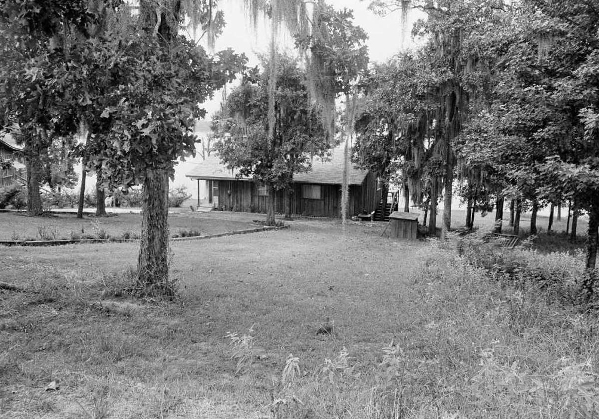 The cabin shown is owned by the family of Dean Corll, 33, the alleged central figure in the nations worst mass slaying case, Aug.15, 1973, near Lake Sam Rayburn, Broaddus, Texas. Owners of cabins in the area say they saw Elmer Wayne Henley, 17, and David Brooks, 18, the men charged in the slayings, visit the cabin frequently. Sheriffs deputies searched the cabin and found torture items inside the cabin and under it. (AP Photo)
