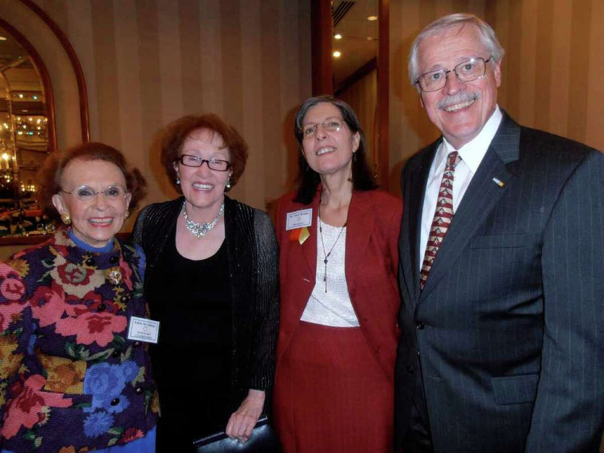 Honorary co-chair Edith McAllister, from left, meets with Estrella Award winner Laura Richmond, founder and executive director Dr. Janet Realini and Bill Moll at the Healthy Futures of Texas luncheon.