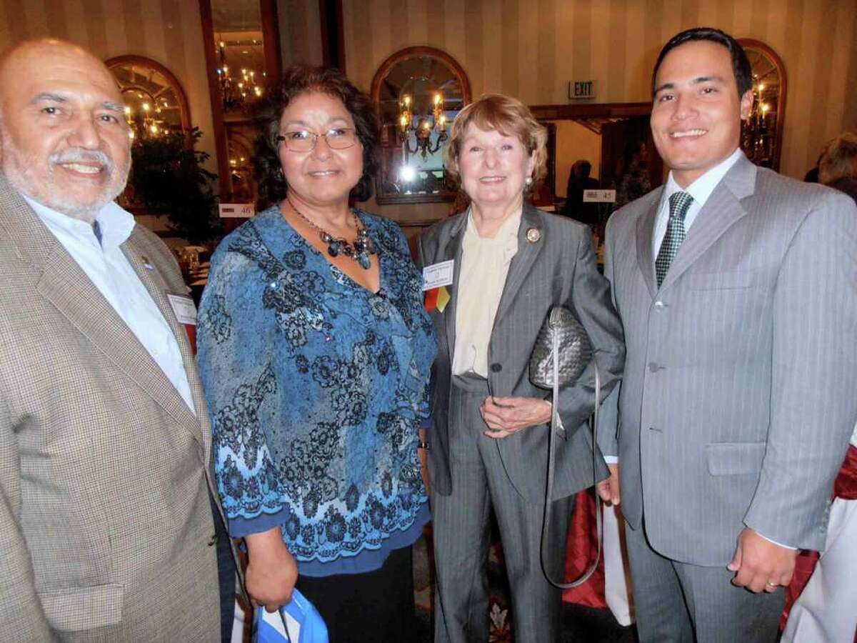 At the Healthy Futures luncheon Tuesday, board member Richard Alvarado, from left, joins Rosa Vasquez, board member Virginia Nicholas and Chris Carmona in supporting efforts to educate teens to delay pregnancy.