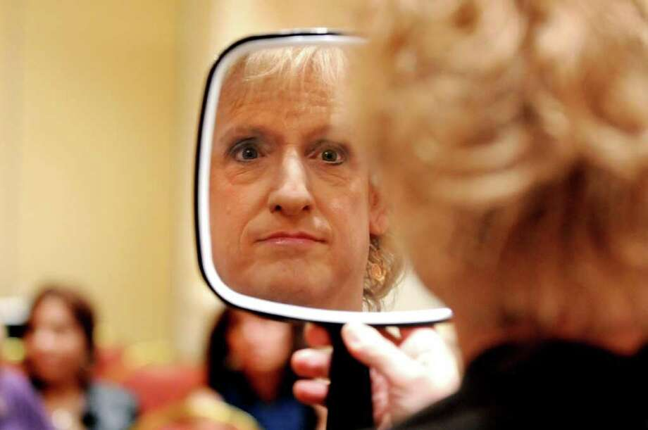 Avi Rone of Rensselaer checks out the make over during TransEvent 2011 on May 6, 2011, at the Crowne Plaza in Albany, N.Y. (Cindy Schultz / Times Union) Photo: Cindy Schultz, Albany Times Union