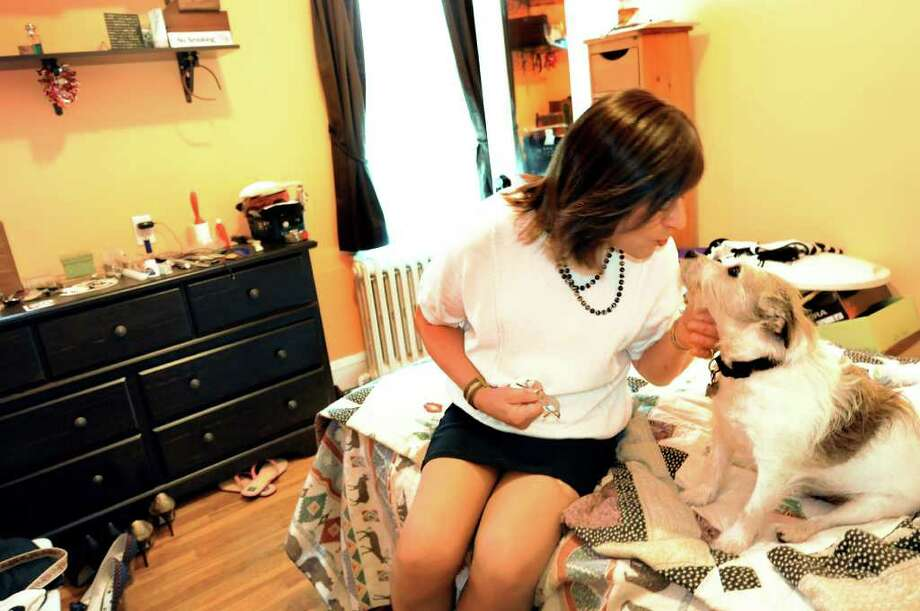 Mona Rae Mason and her Jack Russell in her room on May 24, 2011, in Albany, N.Y. (Cindy Schultz / Times Union) Photo: Cindy Schultz, Albany Times Union