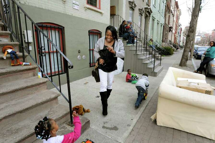 Kym Dorsey greets a neighborhood child on Pearl Street on Monday, April 11, 2011, in Albany, N.Y. (C