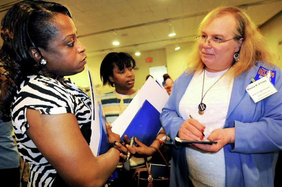 Kym Dorsey, left, meets a fellow transgender woman, Shauna O'Toole, a high school science teacher in Wayne County, during the Empire State Pride Agenda Conference on Monday, May 9, 2011, at the Conference Center in Albany, N.Y. (Cindy Schultz / Times Union) Photo: Cindy Schultz, Albany Times Union