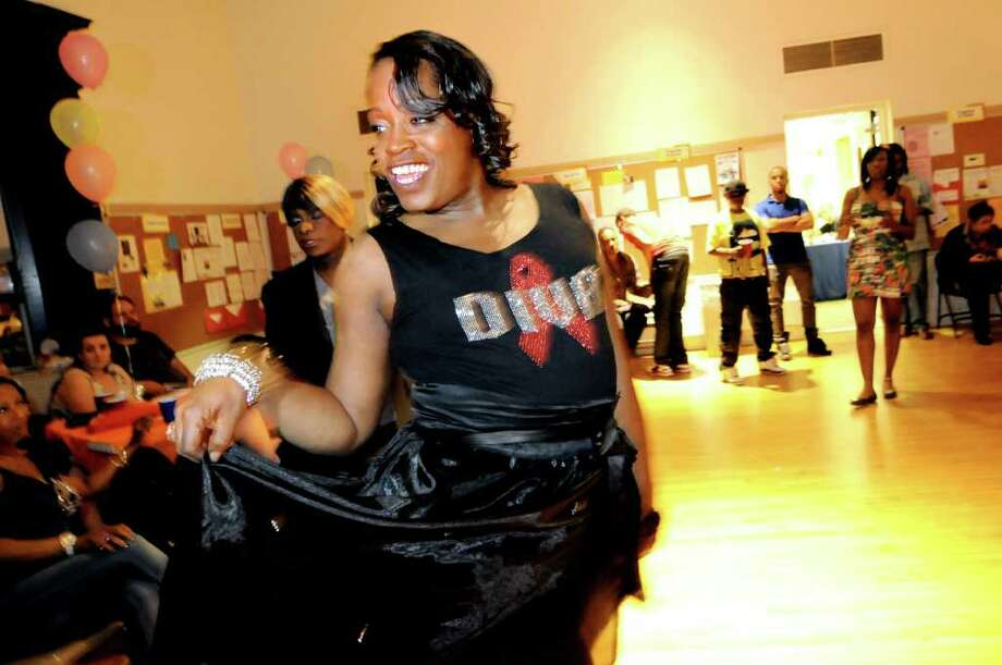 Kym Dorsey, center, lip syncs as she performs during the Black and Latino Gay Pride Sober Dance on Friday, June 3, 2011, at the First Unitarian Universalist Society in Albany, N.Y. (Cindy Schultz / Times Union) Photo: Cindy Schultz, Albany Times Union
