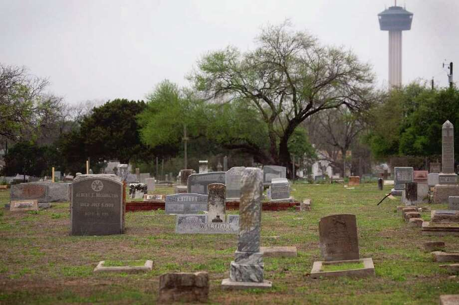 Unmarked graves can be difficult to locate in East Side cemeteries, but burial records can be found in the Texana/Geneology Room of Central Library, 600 Soledad Plaza. Photo: NICOLE FRUGE, SAN ANTONIO EXPRESS-NEWS / nfruge@express-news.net