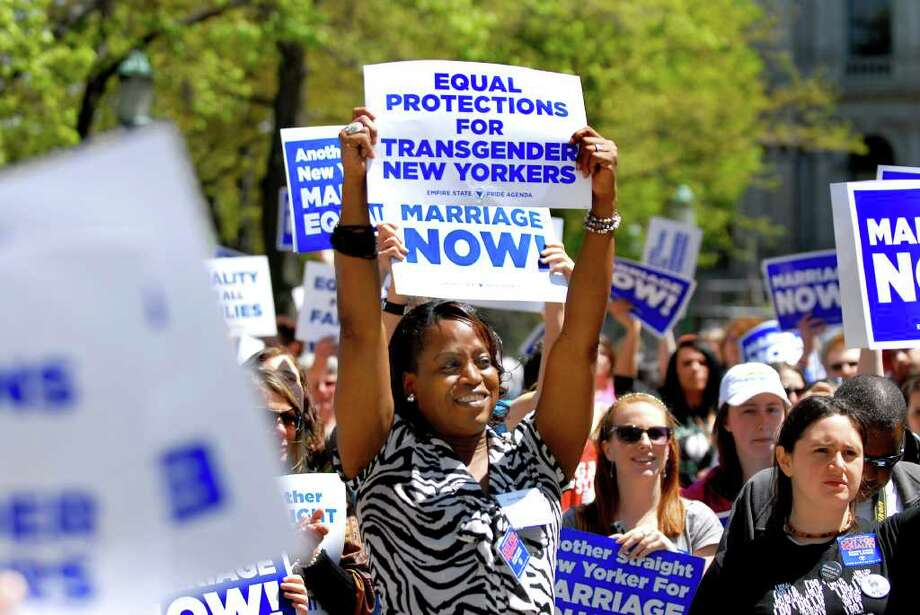 Kym Dorsey, center, holds a sign to support the Gender Expression Non-Discrimination Act during a Pride Agenda rally on Monday, May 9, 2011, at the Capitol in Albany, N.Y. (Cindy Schultz / Times Union) Photo: Cindy Schultz, Albany Times Union