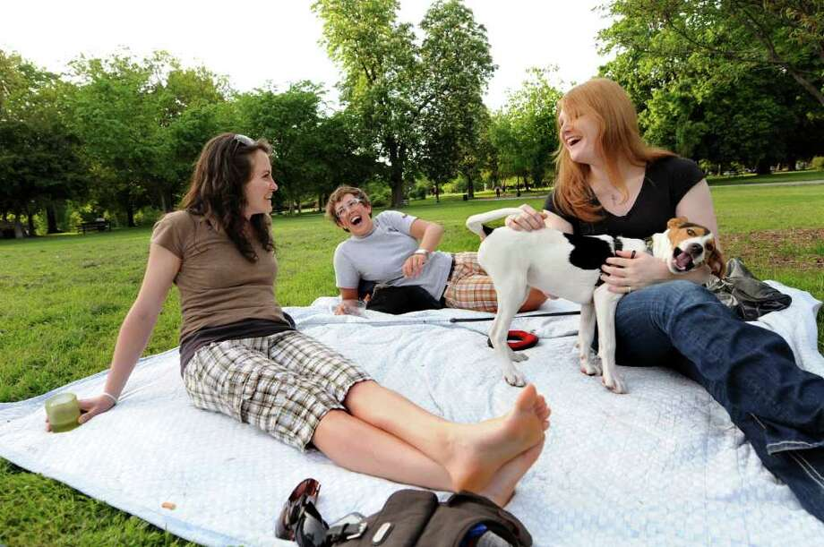 Drew Cordes of Albany, right, meets up with friends Aela Mass, left, and Alyssa Hackett on May 25, 2011, at Washington Park in Albany, N.Y. Drew, who's been transitioning from a man to a woman for seven years, was trying to keep mind off her upcoming gender-reassignment surgery. (Cindy Schultz / Times Union) Photo: Cindy Schultz, Albany Times Union