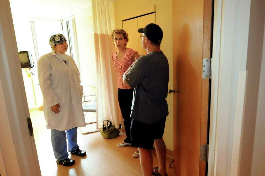 Plastic surgeon, Dr. Maud Belanger, left, talks with Janet and John Cordes, Drew's parents, on Monday, May 30, 2011, at Centre Metropolitain de Chirurgie Plastique in Montreal, Quebec in Canada. (Cindy Schultz / Times Union) Photo: Cindy Schultz, Albany Times Union
