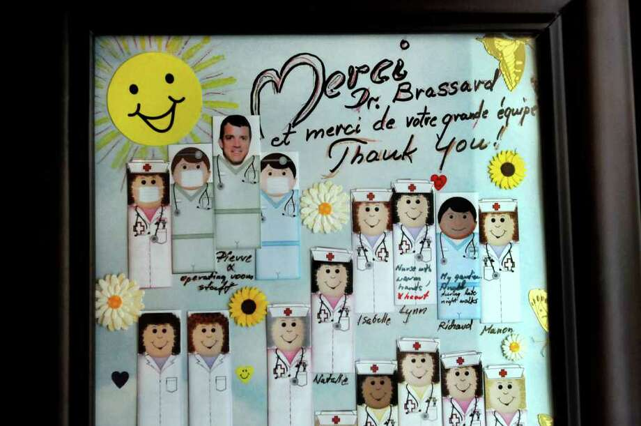 Framed artwork to thank plastic surgeon Dr. Pierre Brassard on Monday, May 30, 2011, at Centre Metropolitain de Chirurgie Plastique in Montreal, Quebec in Canada. (Cindy Schultz / Times Union) Photo: Cindy Schultz, Albany Times Union