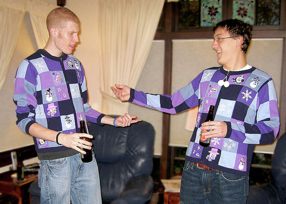 Purple Christmas Sweaters? Christmas for the color blind. TheUglySweaterShop, Flickr Photo: TheUglySweaterShop, Flickr
