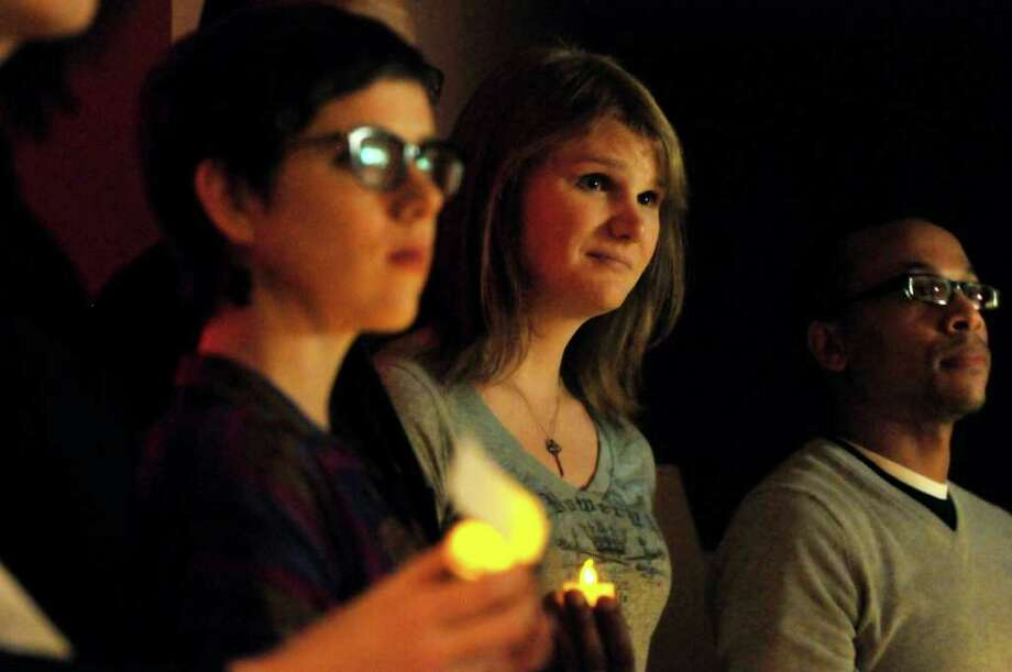 Drew Cordes, center, takes part in Transgender Day of Remembrance on Sunday, Nov. 20, 2011, at First Unitarian Universalist Society in Albany, N.Y. The event featured speakers and a candlelight vigil for those who've been murdered because they were transgender. At right is Jasan Ward of In Our Own Voices. (Cindy Schultz / Times Union) Photo: Cindy Schultz, Albany Times Union