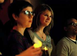 Drew Cordes, center, takes part in Transgender Day of Remembrance on Sunday, Nov. 20, 2011, at First Unitarian Universalist Society in Albany, N.Y. The event featured speakers and a candlelight vigil for those who've been murdered because they were transgender. At right is Jasan Ward of In Our Own Voices. (Cindy Schultz / Times Union)