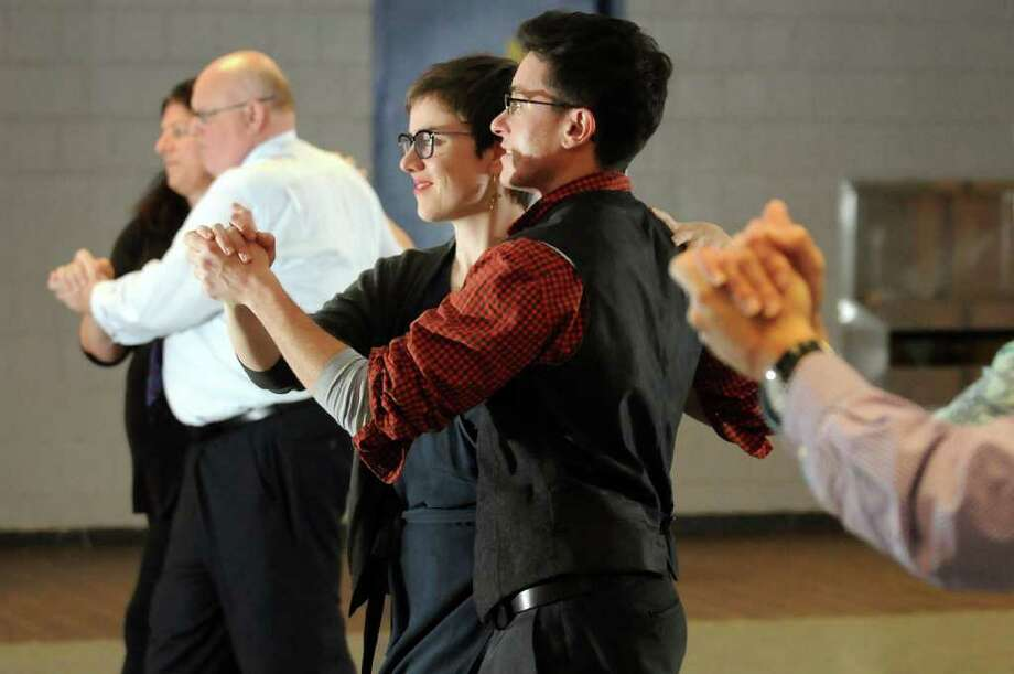 Transgender man Christopher Argyros, center, learns dance steps with his girlfriend Laura Blosser during ballroom dance lessons on Thursday, Nov. 3, 2011, at Albany High in Albany, N.Y. (Cindy Schultz / Times Union) Photo: Cindy Schultz, Albany Times Union