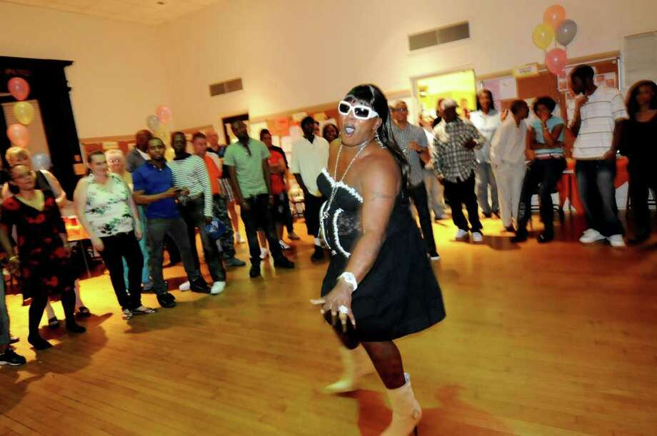 Transgender woman Ladawn Sebastian, center, dances in drag for entertainment during the Black and Latino Gay Pride Sober Dance on Friday, June 3, 2011, at the First Unitarian Universalist Society in Albany, N.Y.  (Cindy Schultz / Times Union) Photo: Cindy Schultz, Albany Times Union