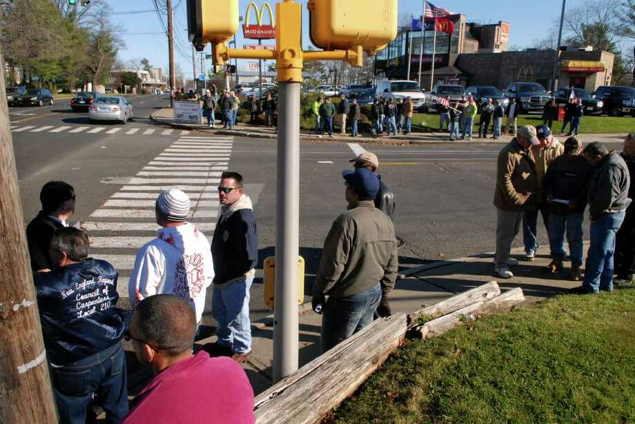 About 60 members of the New England Regional Council of Carpenters protest the management practices of AP Construction at the corner of Blachley  Rd. and E. Main St. near the Chelsea Piers construction site on Thursday December 1, 2011. Photo: Dru Nadler / Stamford Advocate Freelance