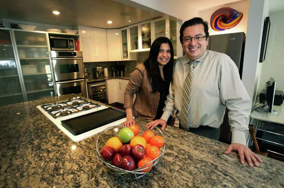 Magoli and Eduardo Garcia in their remodeled kitchen in Alamo Heights home. Wednesday, Nov. 16, 2011. Photo Bob Owen/rowen@express-news.net Photo: BOB OWEN, SAN ANTONIO EXPRESS-NEWS / rowen@express-news.net