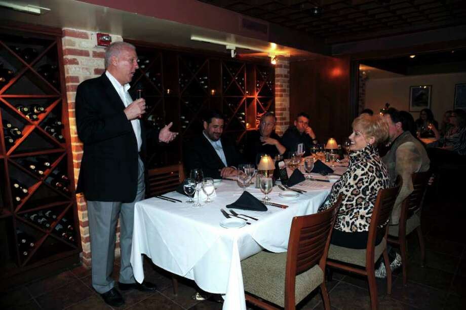 San Antonio Spurs head coach Gregg Popovich speaks during a wine dinner at Ruth's Chris Steakhouse on Wednesday, Nov. 30, 2011. BILLY CALZADA / gcalzada@express-news.net Photo: BILLY CALZADA, SAN ANTONIO EXPRESS-NEWS / gcalzada@express-news.net
