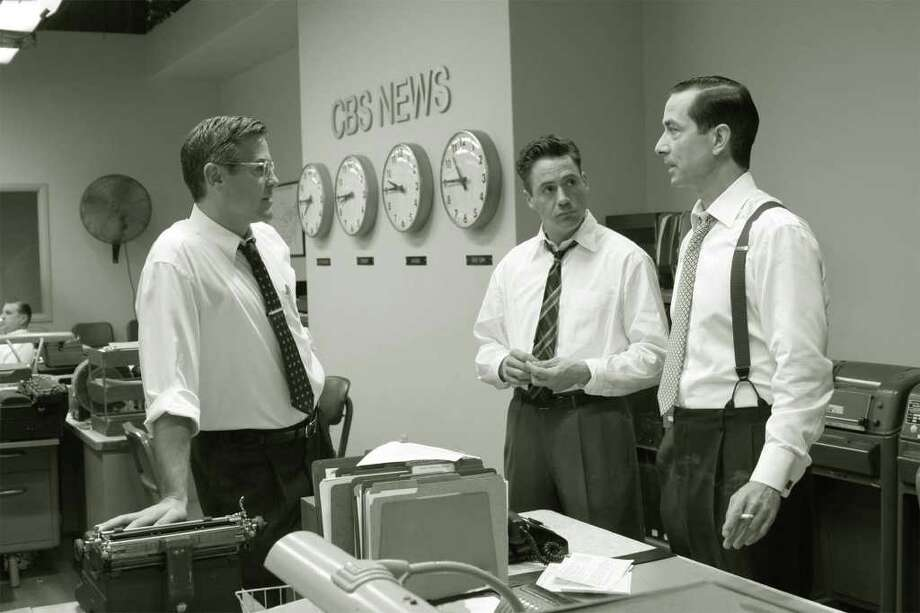 "**FILE**This 2005 file photo originally supplied by Warner Independent Pictures shows, from left, George Clooney, Robert Downey Jr.and  David Strathairn in a scene from ""Good Night, And Good Luck."" The National Board of Review of Motion Pictures gave its best-picture award to the film Monday,Dec. 12, 2005.  Clooney co-wrote the screenplay, directed and stars in the film. Strathairn plays Edward R. Murrow and Clooney his producer, Fred Friendly. Downey plays Joe Wershba. (AP Photo/Warner Independent Pictures, Melinda Sue Gordon) Photo: MELINDA SUE GORDON / WARNER INDEPENDENT PICTURES"