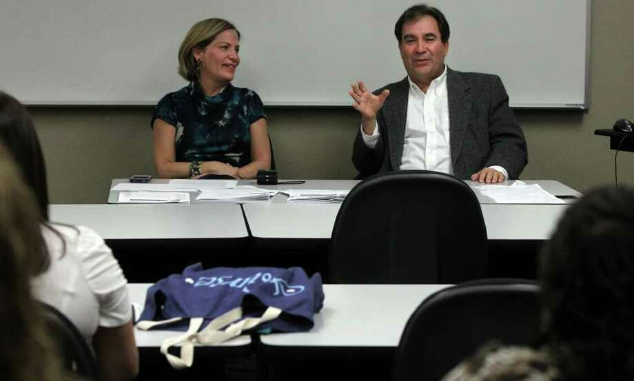 Doctor Adam Ratner (right) and his wife Varda Ratner (left) teach nursing students at Wayland Baptist Nursing School about The Patient Institute and how the students can help patients navigate the healthcare system. The program helps patients find doctors, prepare for doctor visits and more. Photo: JOHN DAVENPORT, SAN ANTONIO EXPRESS-NEWS / SAN ANTONIO EXPRESS-NEWS (Photo can be sold to the public)